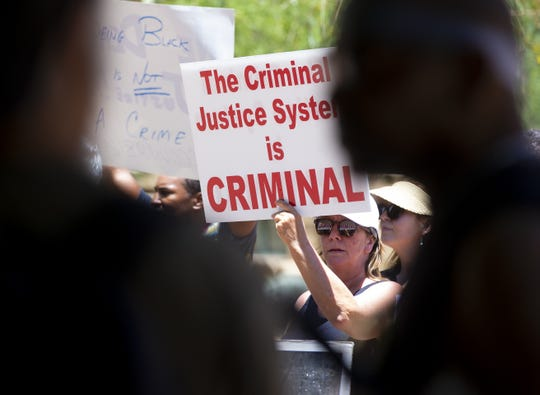 Michelle Tremblay, of Phoenix, protests recent actions of the Phoenix police department in which many view as racist and an example of police brutality.