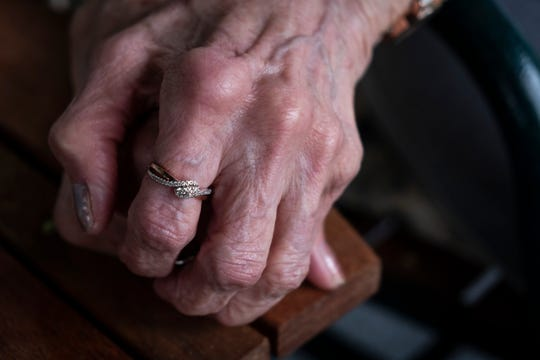 Irene Kotas wears a promise ring given to her by George Hoyer. Hoyer and Kotas, ages 90 and 85, are getting married this weekend in Marine City.