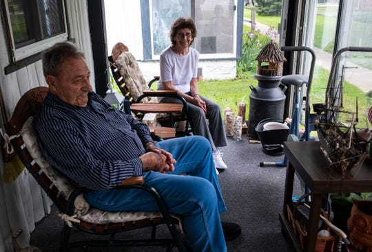 George Hoyer, left, and Irene Kotas, talk on the front porch of Hoyer's Marine City home Thursday, June 20, 2019. Hoyer and Kotas, ages 90 and 85, are getting married this weekend in Marine City.