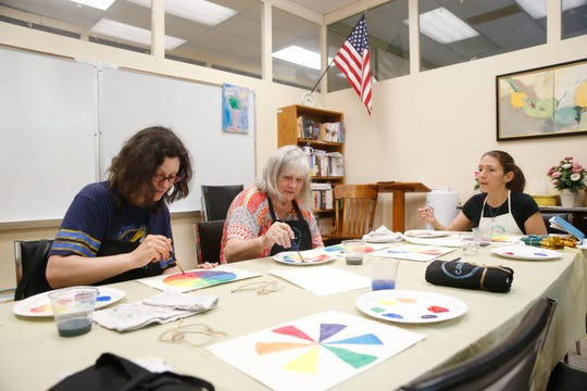 From left, Heather & Barbara Rook take a class on canvas painting from Courtney Skeen at Red Hook Community Center in Red Hook on June 19, 2019.