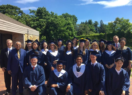 Faith Christian Academy's graduating class poses together.