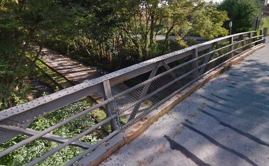 The Singer Road bridge, which crosses perpendicularly above the Heritage Rail Trail in New Freedom, was built in 1905 by the Pennsylvania Railroad