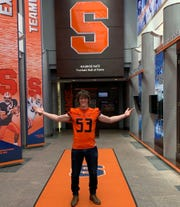 York Suburban's Garth Barclay verbally committed to play football at Syracuse University on Wednesday. He is shown in this photo at the football facility on his visit in June.