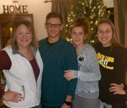 The cancer journey kept Rylee Dorer (far right) apart from her family at times. From left are her mom, Amanda Pross, and brother and sister, Corbin and Dalaney Dorer.
