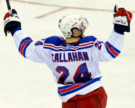 New York Rangers' Ryan Callahan celebrates after scoring against the New Jersey Devils in the third period of an NHL hockey playoff game Wednesday night, April 9, 2008, in Newark, N.J.