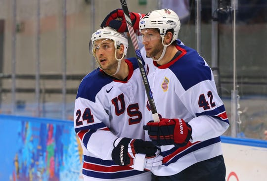 Ryan Callahan, left, celebrates with David Backes after Backes scored during an Olympic win over Slovenia on Feb. 16, 2014,  in Sochi, Russia.