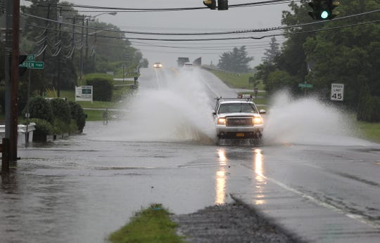 A roadway flooding from a thunderstorm.
