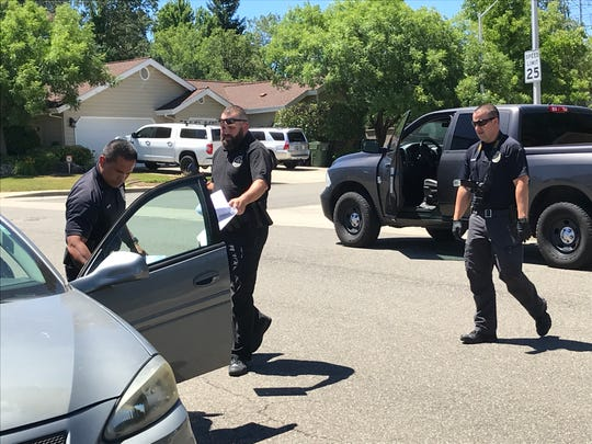 Redding police officers get ready to search a home on Galway Drive on Wednesday afternoon, June 19, 2019, following an alleged attack by Shasta County public defender Theodore Loos on his two children and their mother.