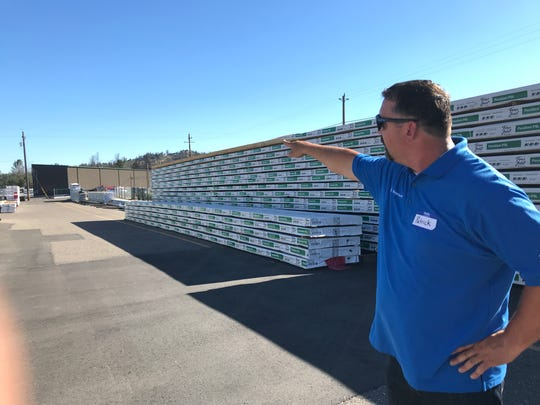 Patrick Costigliolo, site manager for Weyerhaeuser's Redding facility, points to a building that was rebuilt after the Carr Fire. The wildfire nearly destroyed the entire distribution center.