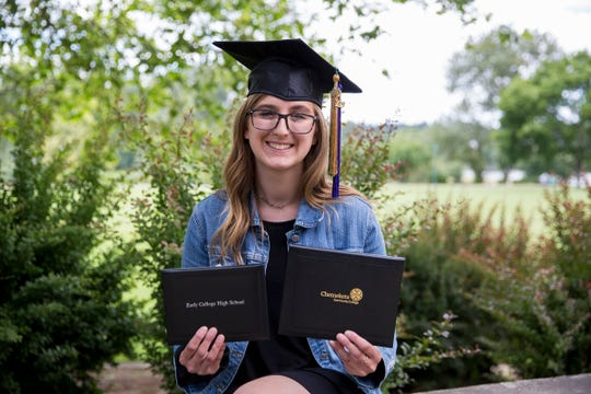 Early College High School graduate, Jazmyne Roeper, poses with two diplomas at Riverfront Park in Salem on June 20, 2019. Roeper graduated with three associate degrees this year.