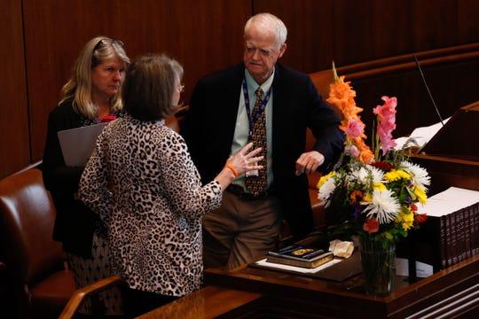 Senate President Peter Courtney, D-Salem, (right) speaks with Senate Democratic Leader Ginny Burdick, D-Portland, and a legislative staff member during the Republican walkout in Salem, Oregon, on Thursday, June 20, 2019.