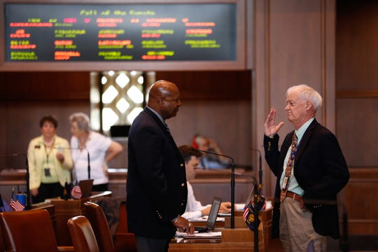 Sen. James Manning Jr., D-Eugene, (left) speaks with Senate President Peter Courtney, D-Salem, on the Senate floor during a Republican walkout in Salem, Oregon, on Thursday, June 20, 2019.