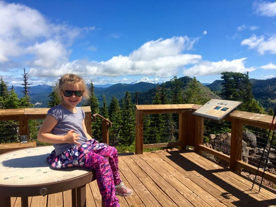Lucy Urness, 4, sits at the summit of Iron Mountain in June 2019.
