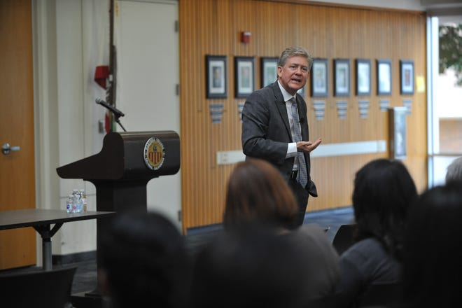 Tony Kinkel, a candidate for Hartnell College's superintendent/president, addresses the public form in Salinas on June 20, 2019.