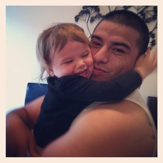 Alexander Rene Durazo holds his daughter Lily in this undated photo.