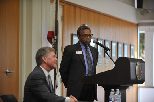From right to left, Robert Griffin, vice president and secretary of PPL, Inc., addresses Hartnell College community members at the superintendent/finalist forum as Tony Kinkel, a candidate, sits listening.