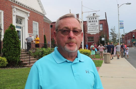 Robert Cowger stands Pocomoke City Hall after being removed as city manager. Cowger said he plans to file suit against the city on June 20, 2019.