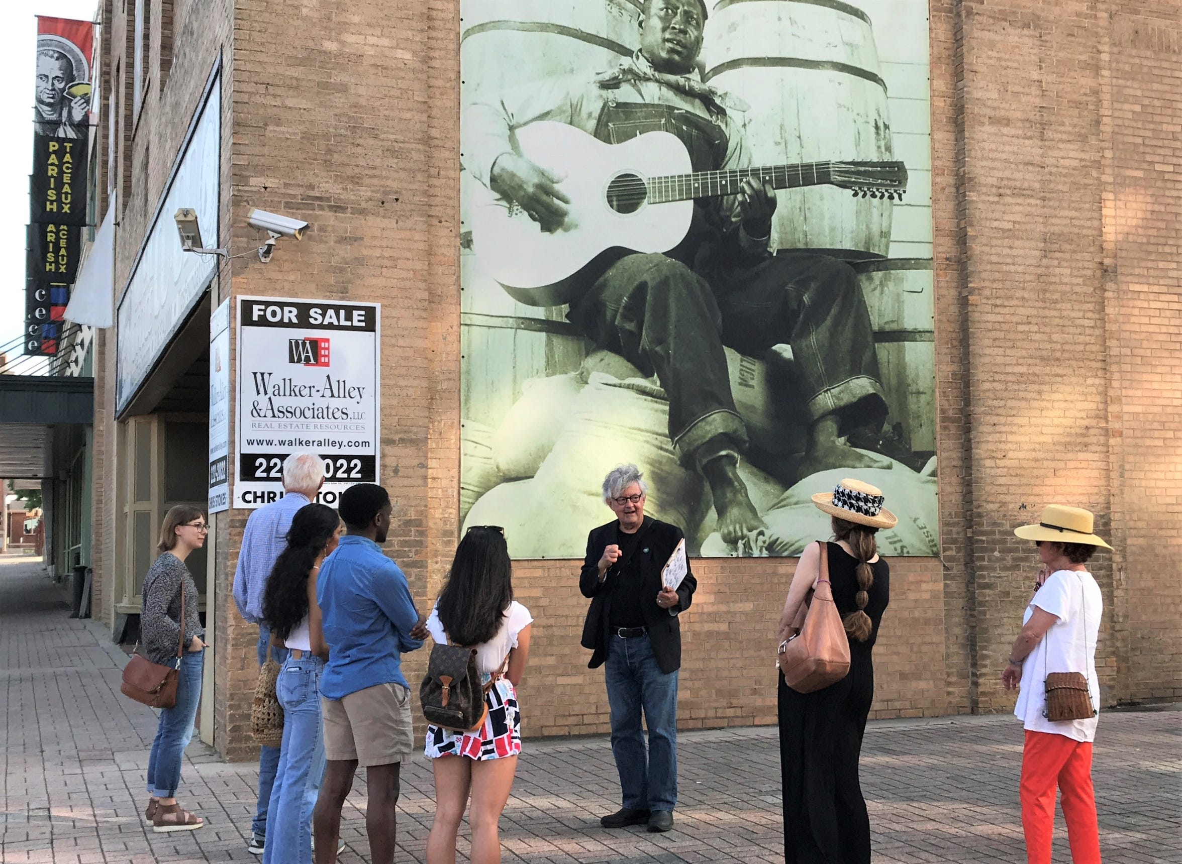 Robert Trudeau talks about the iconic image of Lead Belly on the Music Co-Op building downtown.