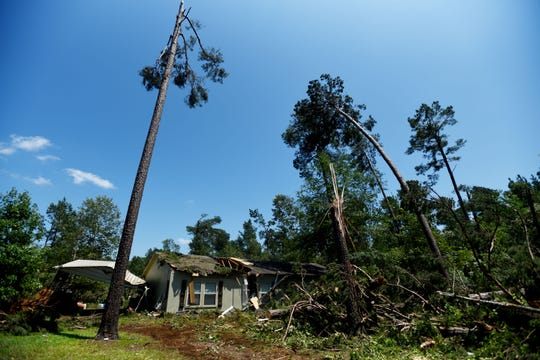 At least three homes were damaged from a tornado Wednesday evening, June 19, 2019, along Butler-Hill Road in Benton.