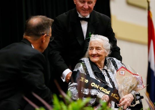 Ozark Nursing and Care Center resident Veldonna Klee is wheeled onto stage to be interviewed by Rob Dvorak during the District 4 Ms. Missouri Nursing Home Pageant at the Oasis Convention Center on Wednesday, June 19, 2019, in Springfield, Mo.