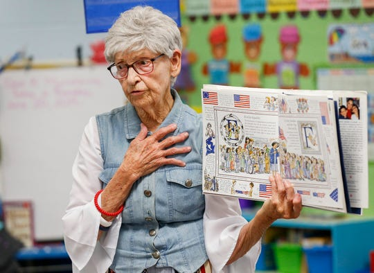 Volunteer Darlene Anderson reads to kindergarten students at McBride Elementary School in Springfield, Mo., on Thursday, June 20, 2019.
