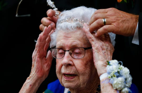 A new tiara is placed onto 94-year-old Murl Moynihan's head after she was named the winner of the District 4 Ms. Missouri Nursing Home Pageant at the Oasis Convention Center on Wednesday, June 19, 2019, in Springfield, Mo.