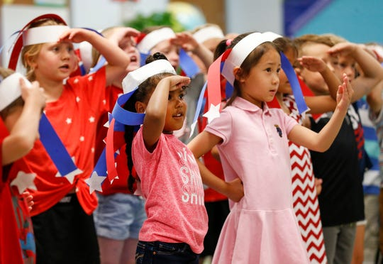 "Kindergarten students at McBride Elementary School perform Lee Greenwood's song ""God Bless the U.S.A."" on Thursday, June 20, 2019 in Springfield, Mo.,"