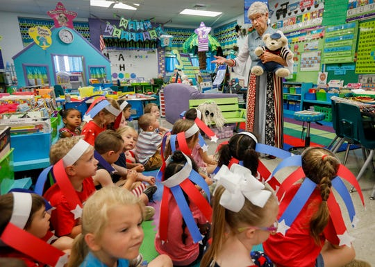 Volunteer Darlene Anderson talks to kindergarten students at McBride Elementary School about patriotism on Thursday, June 20, 2019 in Springfield, Mo.