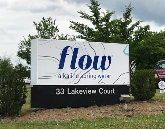 The entry sign for Flow Hydration's Augusta County bottling plant photographed on June 20, 2019, in Mills Place Commerce Park, Verona.