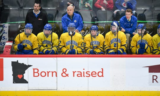 Cathedral head coach Derrick Brown, right, guides his players from the bench during the 2019 state tournament championship semifinals game Friday, March 8, at the Xcel Energy Center in St. Paul.