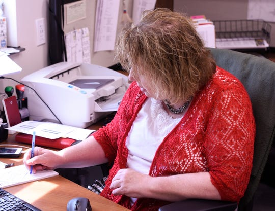 St. Joseph City Administrator Judy Weyrens writes down notes in her office, Tuesday, June 20 at the St. Joseph Government Center. Weyrens moved into her role as administrator in 2000.