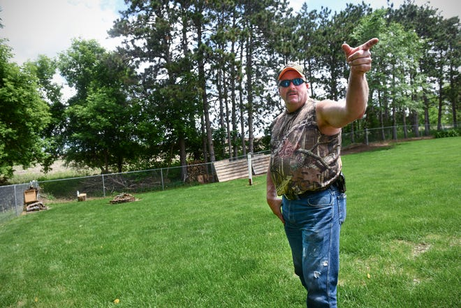 Greg Rakotz outlines the extent of flooding on his property this spring that he contends was caused by a new solar farm nearby during an interview Wednesday, June 19, south of St. Cloud.