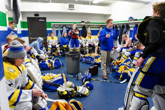 Cathedral head coachÊDerrick BrownÊtalks with players in the locker room before the start of their game against Alexandria Tuesday, Dec. 11, 2018, at the Municipal Athletic Complex in St. Cloud.