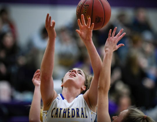 Cathedral's Megan Voit puts up a shot during the Friday, Jan. 18, game at Albany High School. Cathedral won 65-47.
