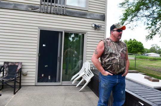 Greg Rakotz talks about how water threatened to enter his house during flooding this spring that he contends was caused by a new solar farm nearby during an interview Wednesday, June 19, south of St. Cloud.