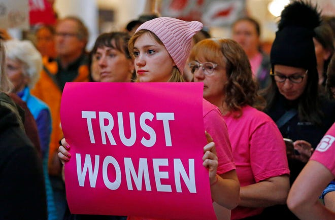 FILE - In this May 21, 2019, file photo, activists gathers with others in the Utah State Capitol Rotunda in Salt Lake City, to protest abortion bans happening in Utah and around the country. The state of Utah is asking a federal judge to let it gather evidence that a ban on abortion after 18 weeks doesn't place an undue burden on women seeking abortions. (AP Photo/Rick Bowmer, File)