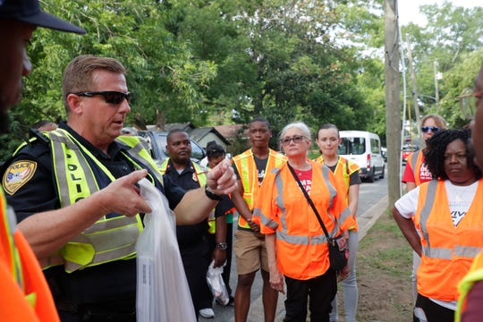 """Volunteers, Tallahassee police officers and city officials gather in the Bond neighborhood for """"Operation Safe Neighborhoods"""" Thursday, June 20, 2019. The program promotes public safety by organizing community walks through TallahasseeÕs neighborhoods"""