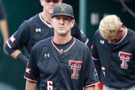 Jun 19, 2019; Omaha, NE, USA; Texas Tech Red Raiders head coach Tim Tadlock walks in the dugout prior to the game against the Florida State Seminoles in the 2019 College World Series at TD Ameritrade Park. Mandatory Credit: Bruce Thorson-USA TODAY Sports