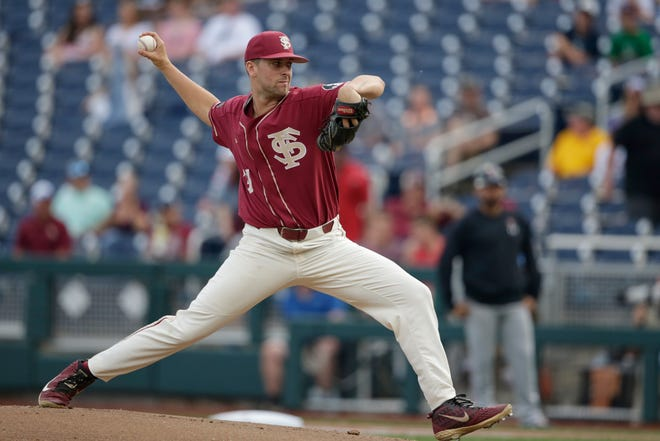 Florida State starting pitcher Conor Grady throws to a Texas Tech batter during the first inning of an NCAA College World Series baseball game in Omaha, Neb., Wednesday, June 19, 2019. (AP Photo/Nati Harnik)