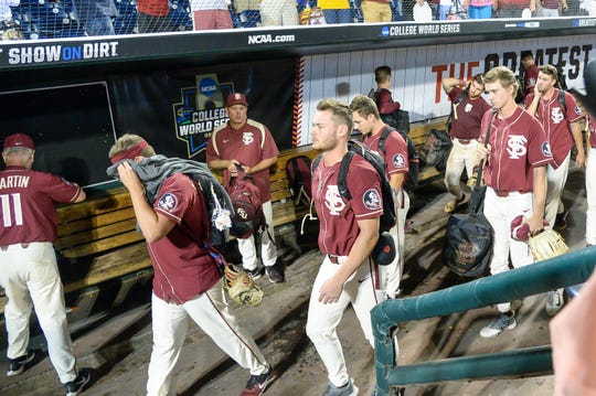 Jun 19, 2019; Omaha, NE, USA; The Florida State Seminoles leaves the dugout after the loss to the Texas Tech Red Raiders in the 2019 College World Series at TD Ameritrade Park. Mandatory Credit: Steven Branscombe-USA TODAY Sports