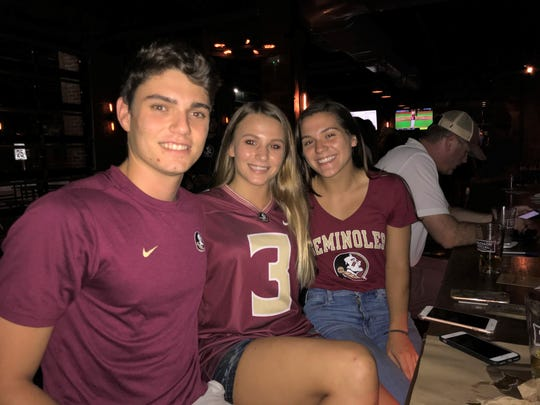 From left to right: Ricardo Villarreal, Rebecca Hays and Ana Rodriguez were at Madison Social in CollegeTown to watch Florida State in the College World Series on Wednesday, June 19, 2019.