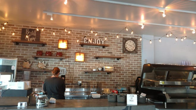 Located in the former Patisserie, the Sun Market Sauce Co. interior has been completely revamped with lots of brick and a gray ceiling draped with patterned fabric to add style and cancel out noise.