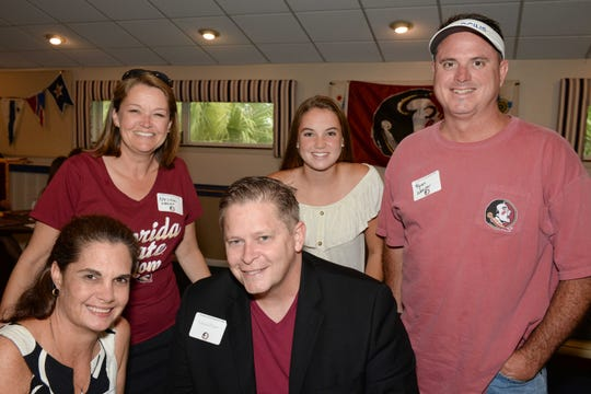 Renee and Shawn Frost, seated, with Melissa, Sara and Ryan Weaver at the Treasure Coast Seminole Club's Sendoff at the Fort Pierce Yacht Club.