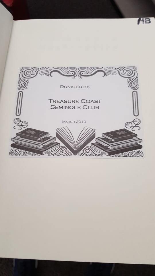 Books donated to the St. Lucie County Library System by the Treasure Coast Seminole Club are identified by this label inside the books' jacket.