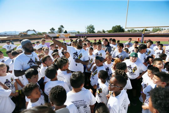 Green Bay Packers running back Aaron Jones talks to children before they start running drills at the Jones Brothers Youth Football Skills Camp on Wednesday, June 19, 2019, at Burges High School in El Paso. This is the third year Alvin and Aaron Jones have hosted the camp. The brothers played football at Burges and were standouts at the University of Texas at El Paso.