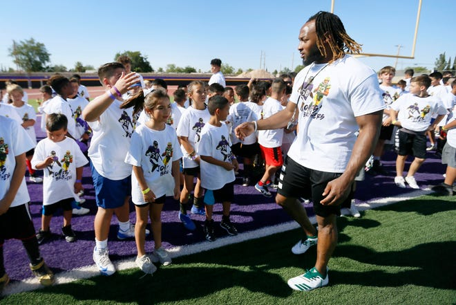 Running back for the Green Bay Packers Aaron Jones talks to the kids before they start running drills at the Jones Brothers Youth Football Skills Camp Wednesday, June 19, at Burges High School in El Paso. This is the third year Alvin and Aaron Jones have hosted the camp. The brothers played football at Burges High School and were standouts at UTEP.