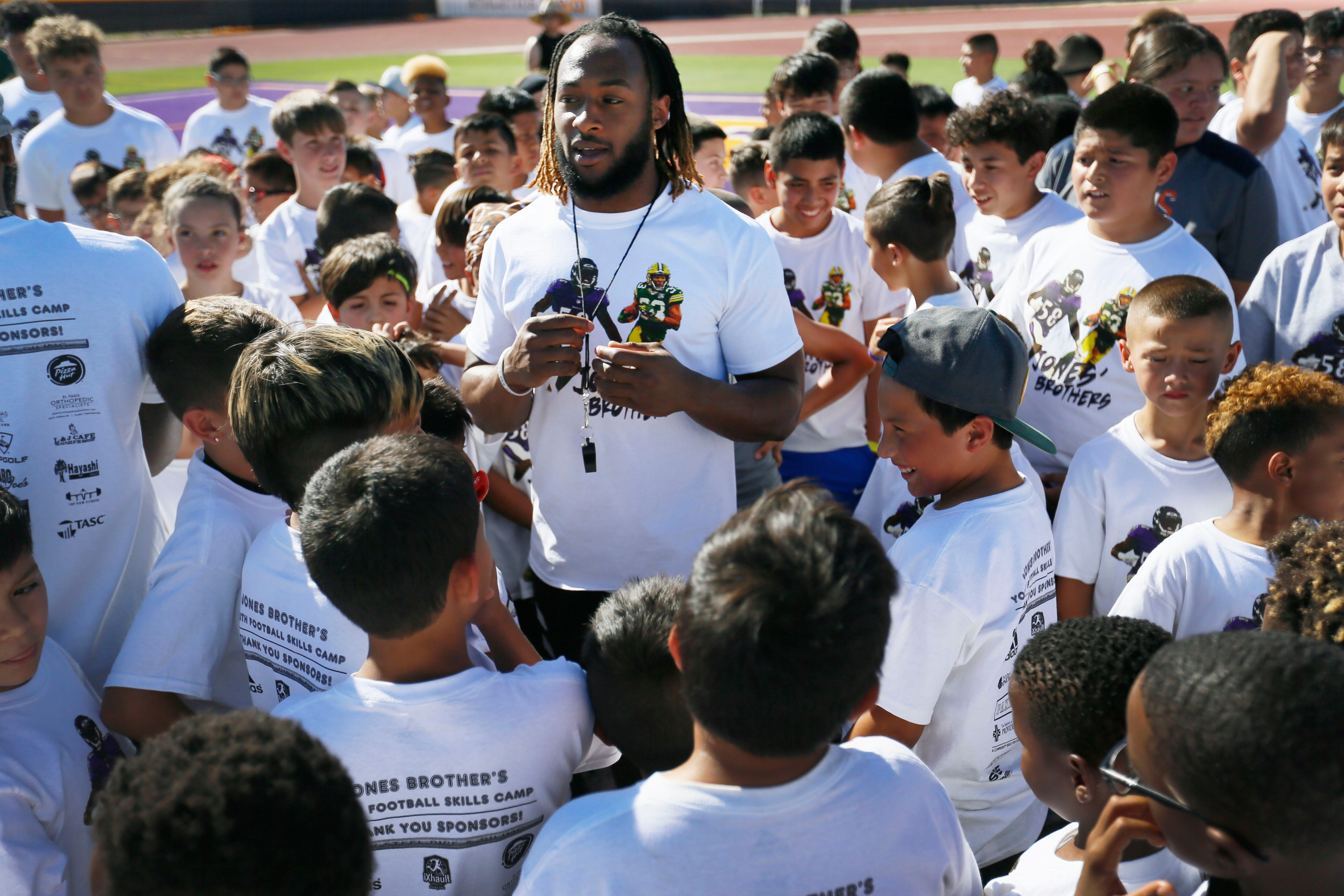 Running back for the Green Bay Packers Aaron Jones talks to the kids before they start running drills at the Jones Brothers Youth Football Skills Camp Wednesday, June 19, 2019 at Burges High School in El Paso. Aaron and Alvin Jones have hosted the camp since 2017. The brothers played football at Burges High School and were standouts at UTEP.