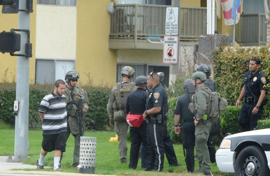A suspect is taken into custody at an apartment complex in the 1400 block of South Victoria Avenue in Oxnard after gunshots were reported on the morning of June 20, 2019.