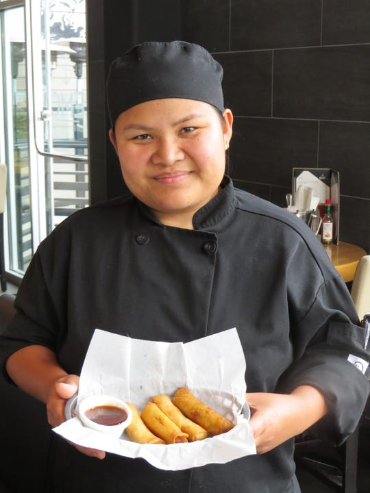 Aliza DuPlantier, executive chef at what is now operating as Louisiana Seafood House by EMC in Oxnard, poses with a basket of egg rolls filled separately with crawfish, vegetables, jambalaya and pork boudin sausage.