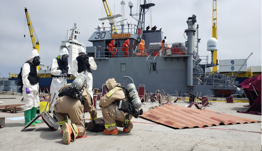 The Ventura County Fire Department's hazardous materials team and Ventura County Sheriff's Office bomb squad identify mock cyanide during the massive Coastal Trident emergency drill.